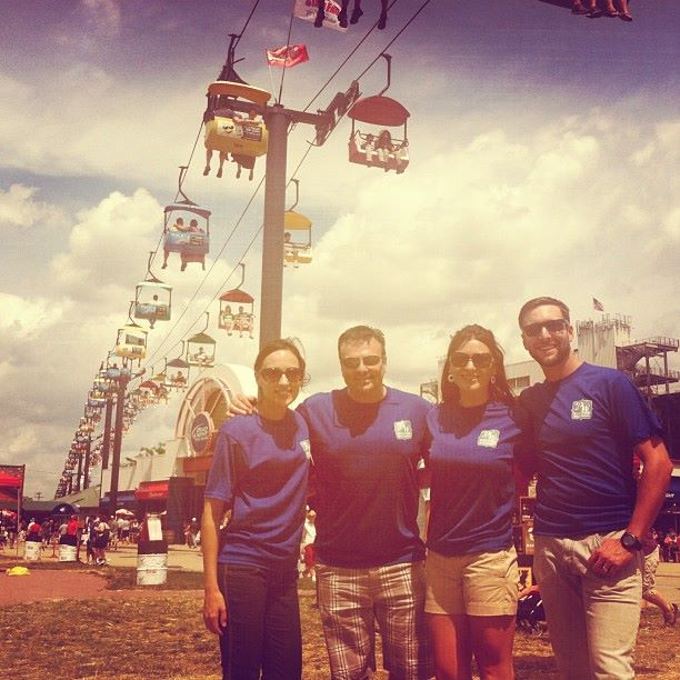 Co-hosts Libby, Eric, Mariah, and Collin huddle under the Wisconsin State Fair Sky Glider.