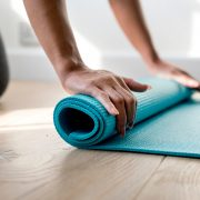 person holding teal mat - Photo by rawpixel on Unsplash