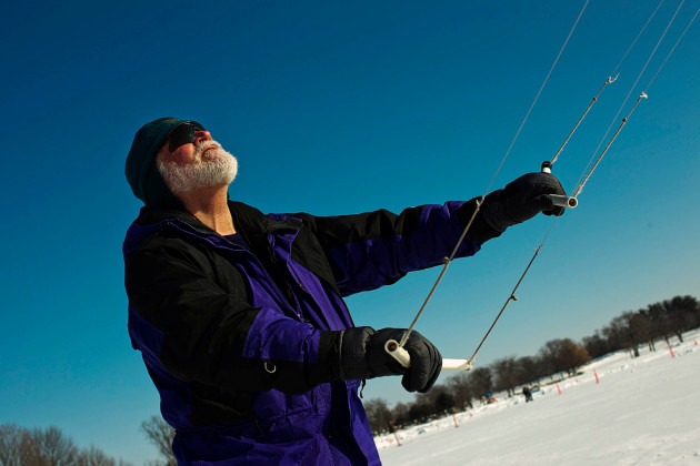 A kite flier keeps his eye on during Sky Circus On Ice. This year's event is Feb. 12-14 at Lake Lawn Resort.
