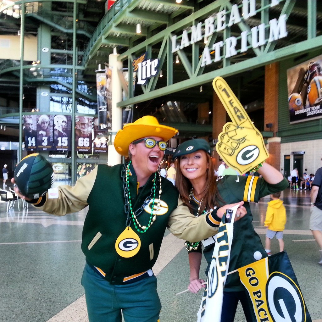Discover Wisconsin hosts Jake Zimmermann and Mariah Haberman model gear from the Packers Pro Shop