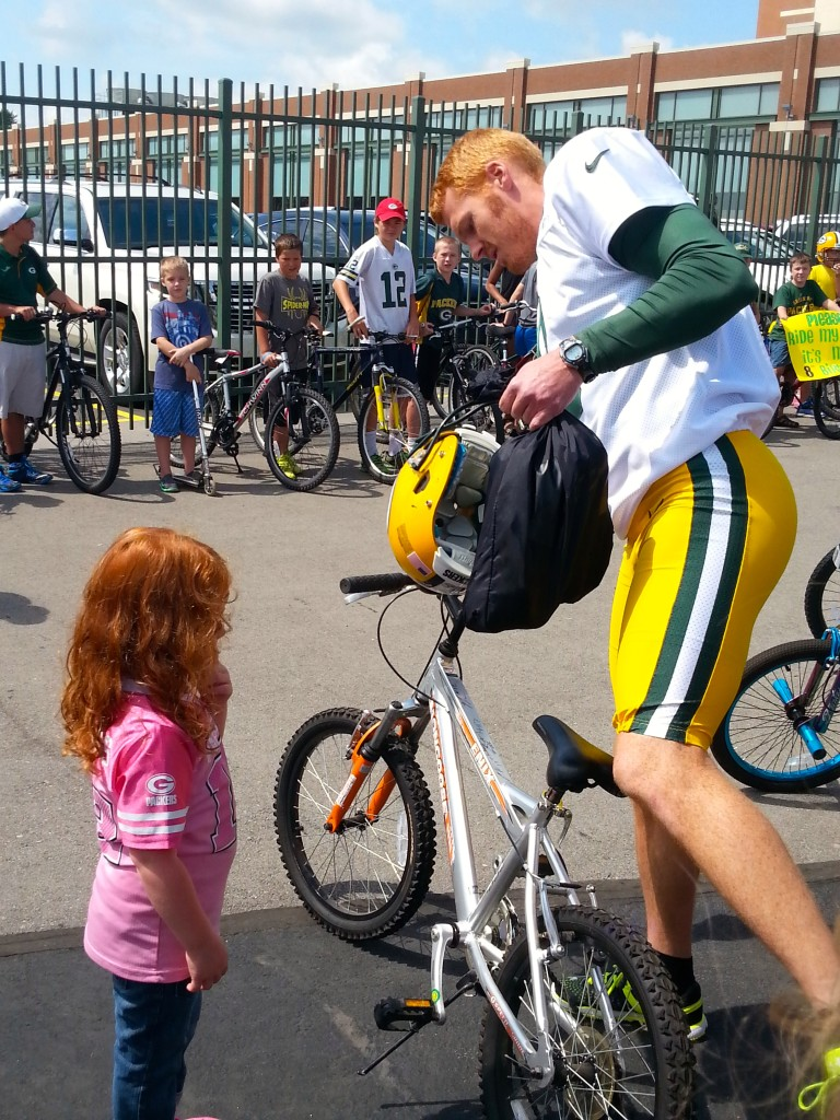 Players take part in a bike riding tradition during Packers Training Camp